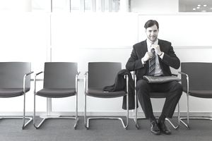 man waiting in office lobby for job interview