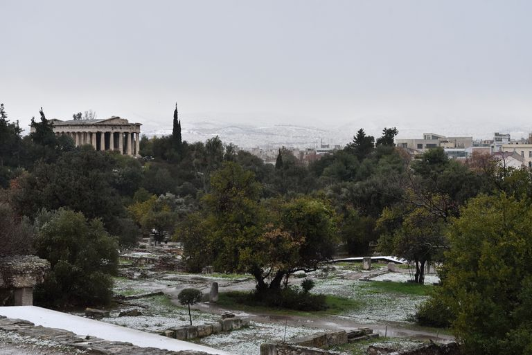 Temple of Hephaestus with snow on December 29, 2016 in Athens