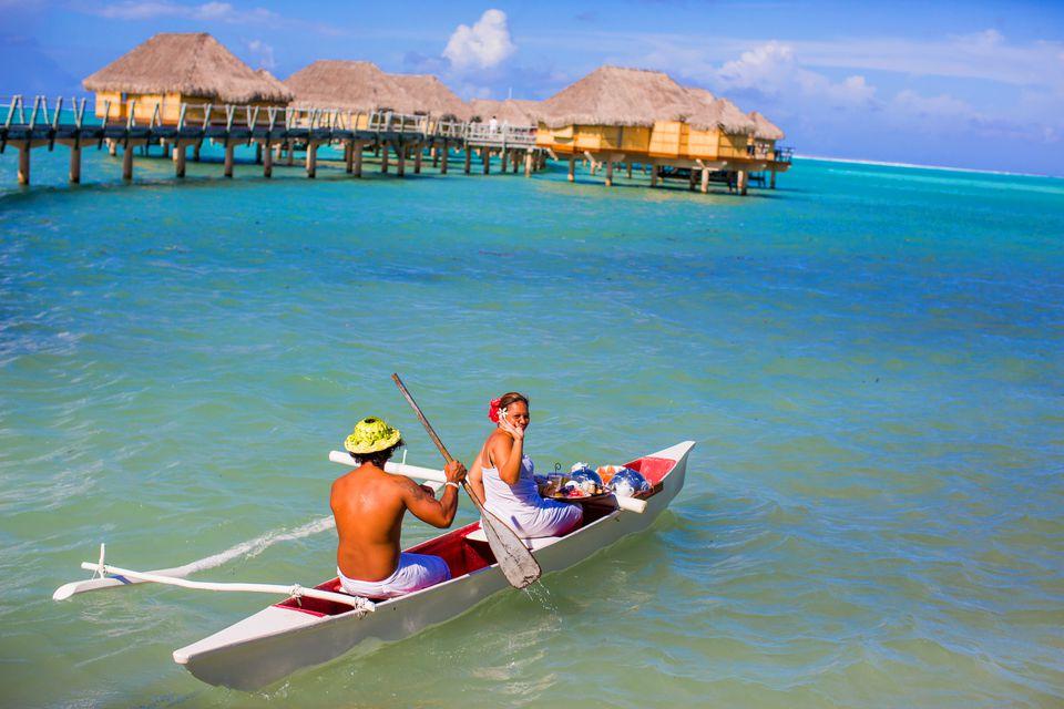 Canoe room service for the overwater bungalows, Le Tahaa Resort, Tahiti