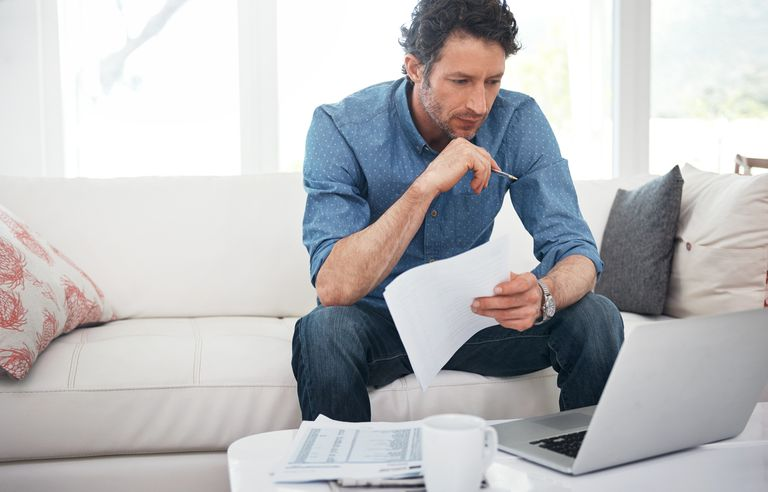 Man with paper and computer