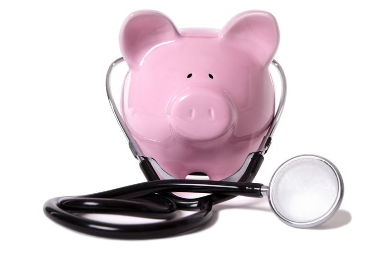 Pink piggy bank with stethoscope
