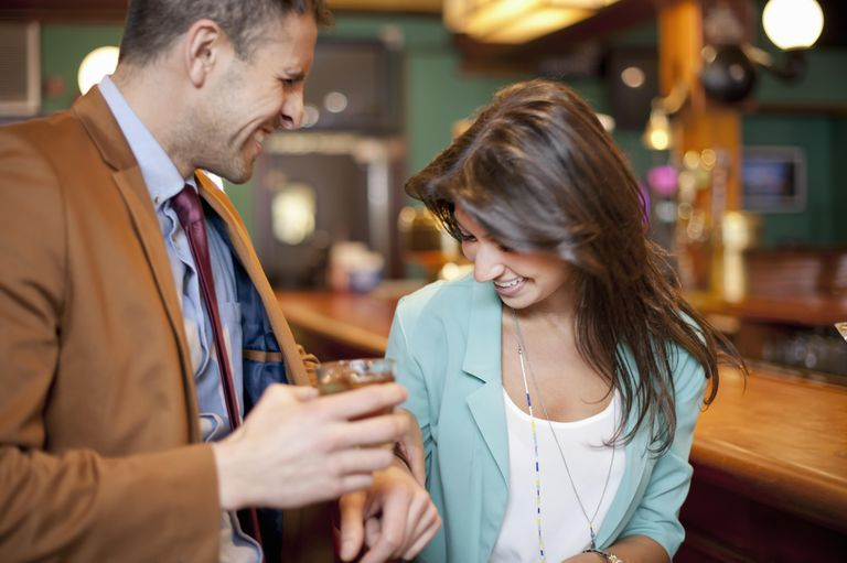 Smiling couple talking at bar