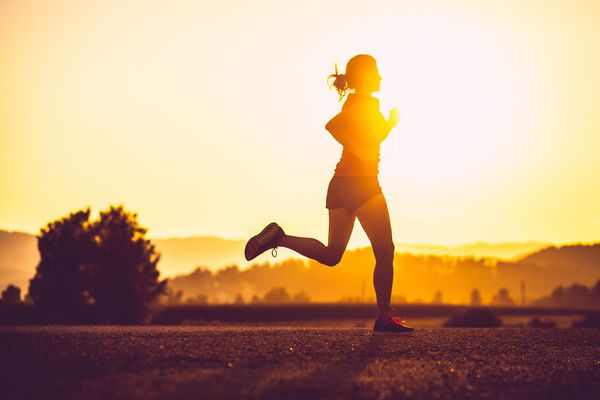 Adult woman running outdoors