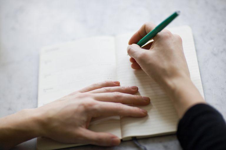Woman writing in a diary