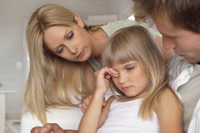 sad girl talking to parents - child discipline