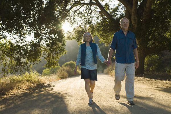 Mature couple walking down dirt road