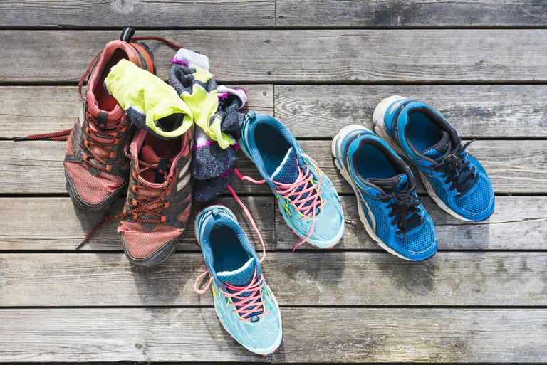 Sports shoes and socks on wooden background