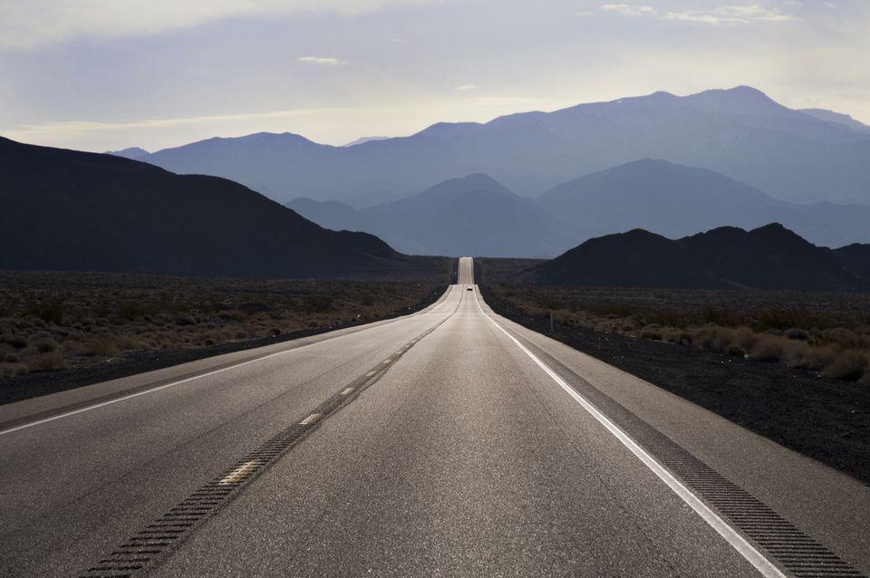 undulating road into desert mountains