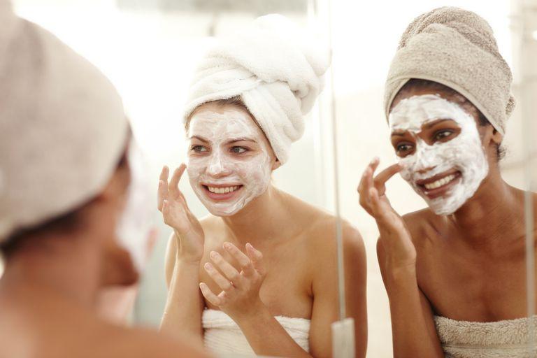 women applying a face mask