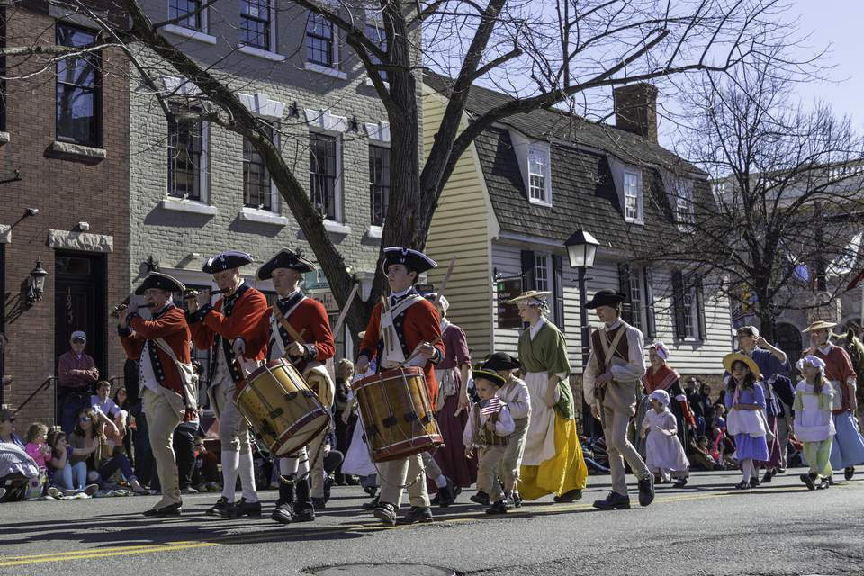 Marchers dressed in colonial garb celebrate George Washington's Birthday in Alexandria, Virginia