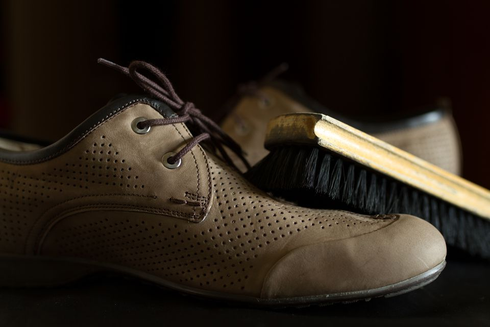 Brush and leather shoes. Shoe Care.