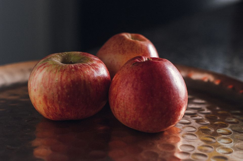red apples over golden font