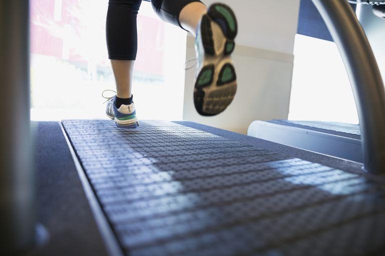 Womens feet running on treadmill at gym