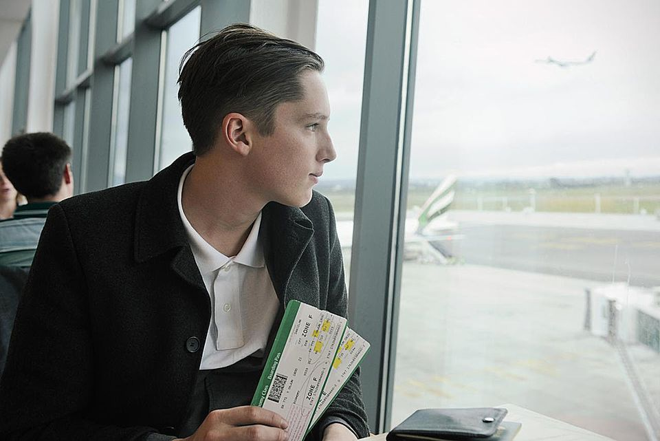 Young man at airport departures