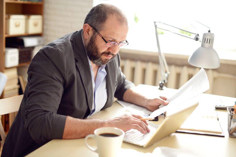man calculating formula on computer