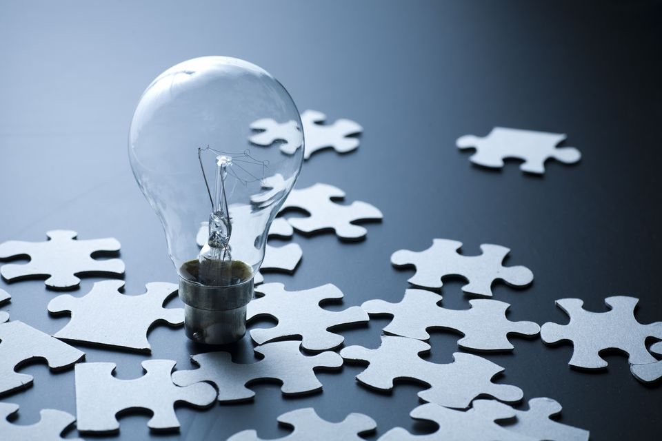 Light bulb and puzzle pieces