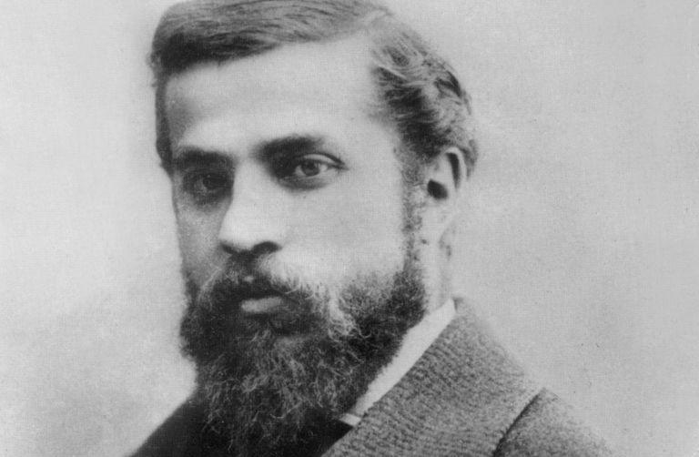 Black and white portrait of architect Antoni Gaudi, dark hair and dark beard