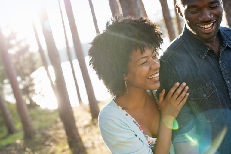 happy couple in wooded area