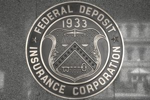 FDIC seal embedded in a building's wall