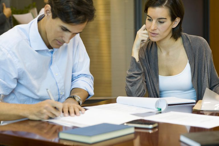 Executives doing paperwork together