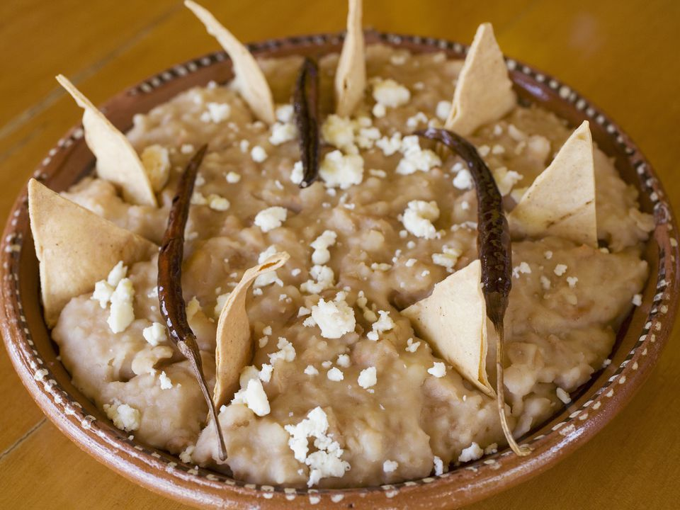 Refried beans with cotija cheese