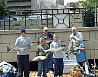 Two Men and Three Kids With Lake Michigan Fish