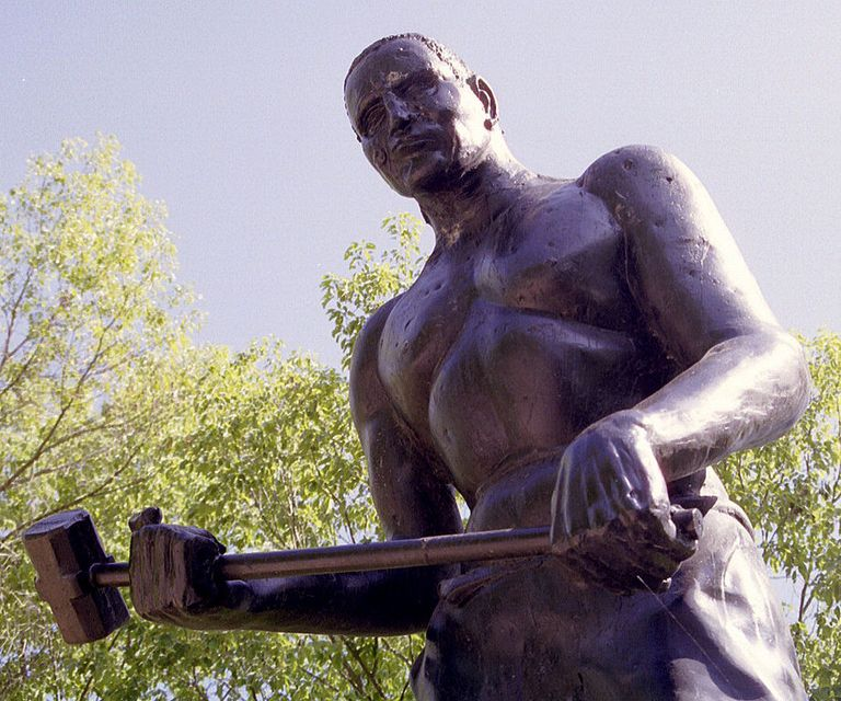 A statue of John Henry on State Highway 12