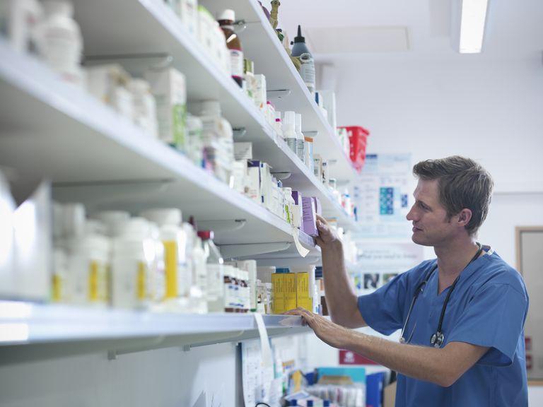 Vet selecting medications from shelf in veterinary pharmacy