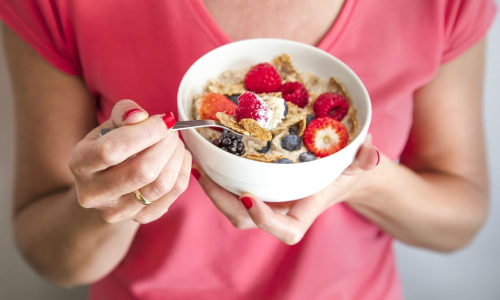 Woman eating fiber in her cereal