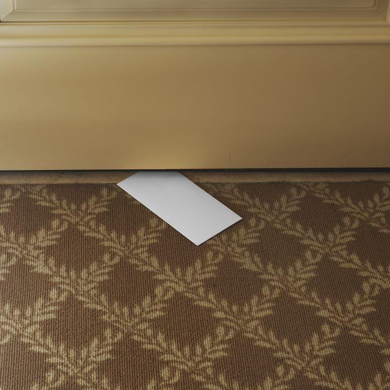 Envelope slipped under a door