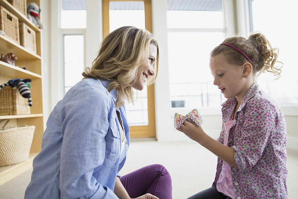 girl showing mom cootie catcher craft