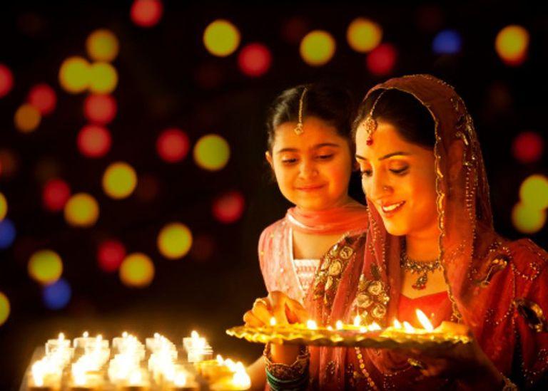 Woman and child celebrating Dewali