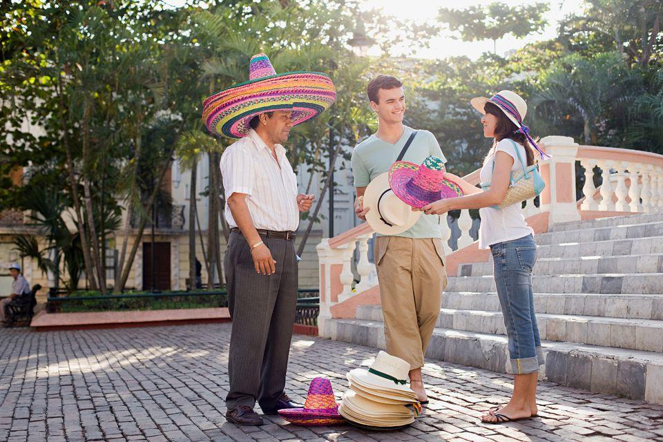 couple buying sombreros