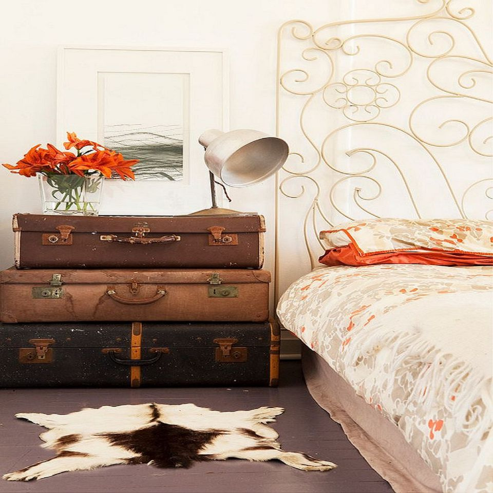 Bedroom with vintage suitcases.
