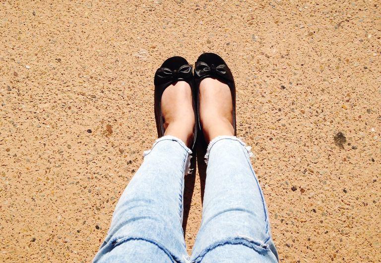 Low Section Of Woman Wearing Black Flat Shoe