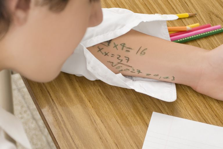 Close-up of a schoolboy copying in an examination