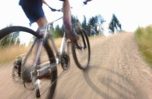 A cyclist climbing a hill quickly