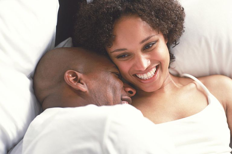 Couple cuddling in bed: Is it OK to breastfeed your husband or partner?