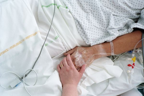 Hospital patient holding hand