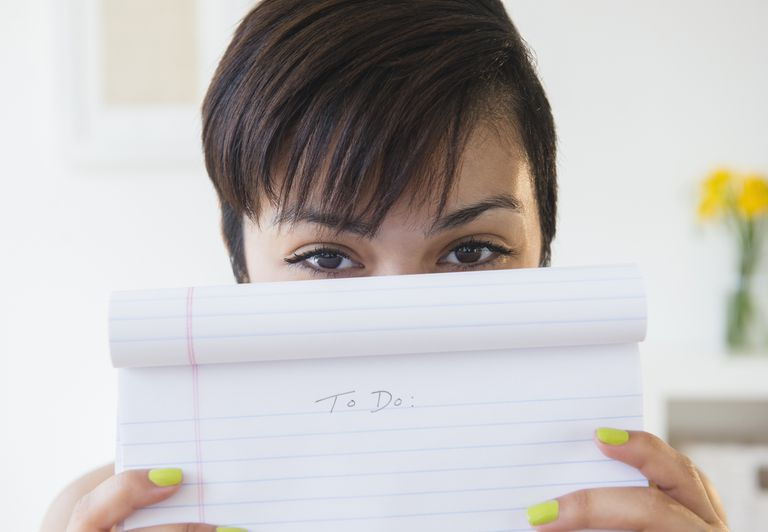 Mixed race woman holding empty to do list