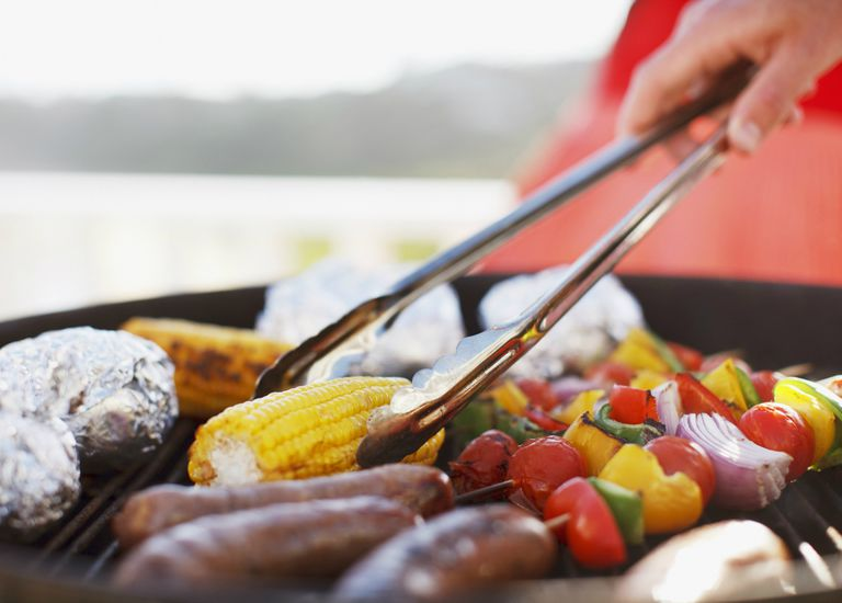 Grilling meat and veggies on barbecue