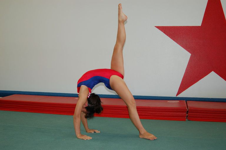 Do a bridge with one leg up to learn a back walkover
