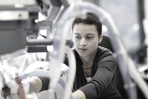 Female Engineer Repairing Medical Device