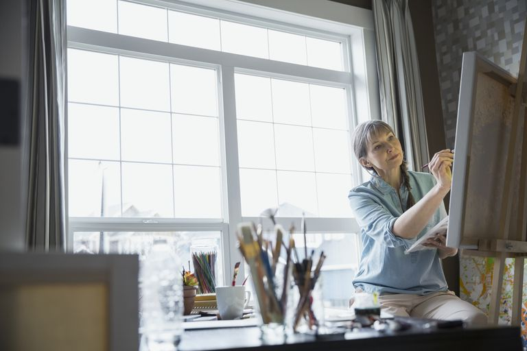 Woman painting in apartment
