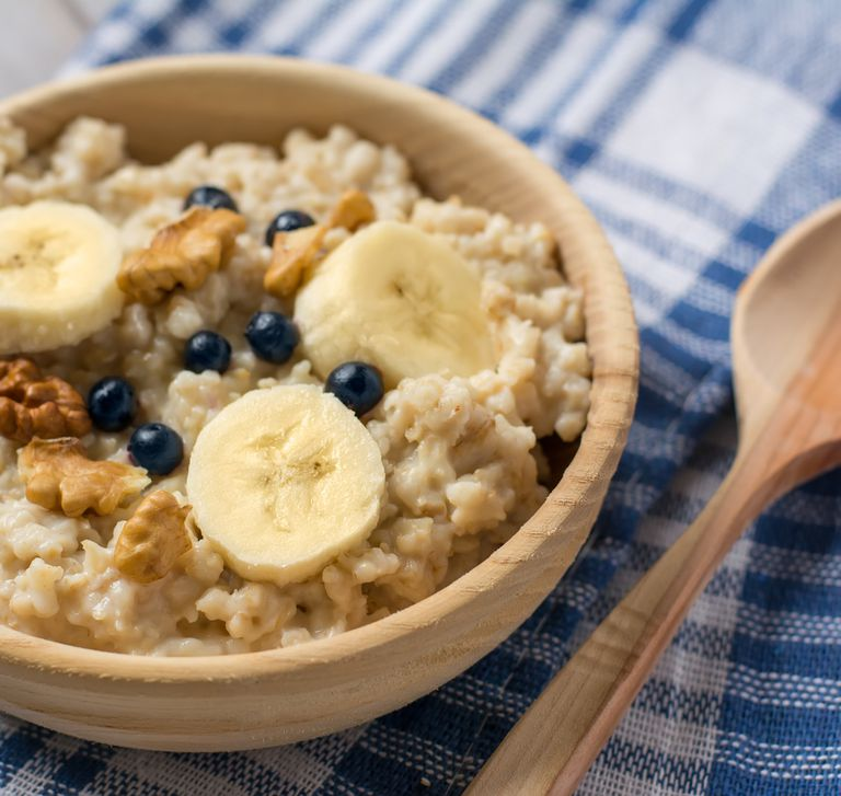 Oatmeal breakfast with bananas, walnuts, and blueberries