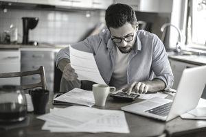 Man calculating retirement goals
