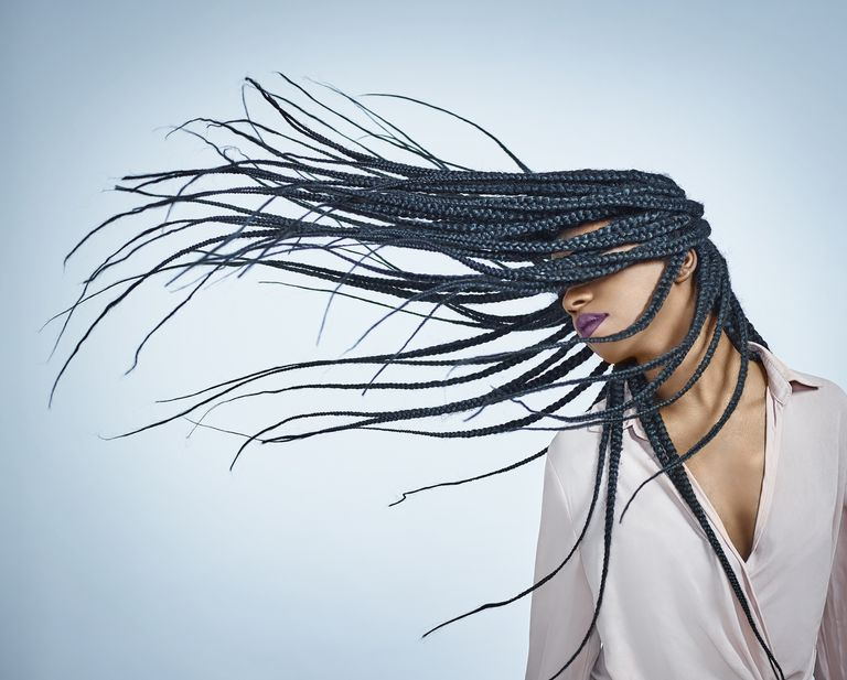 Woman flicking braids