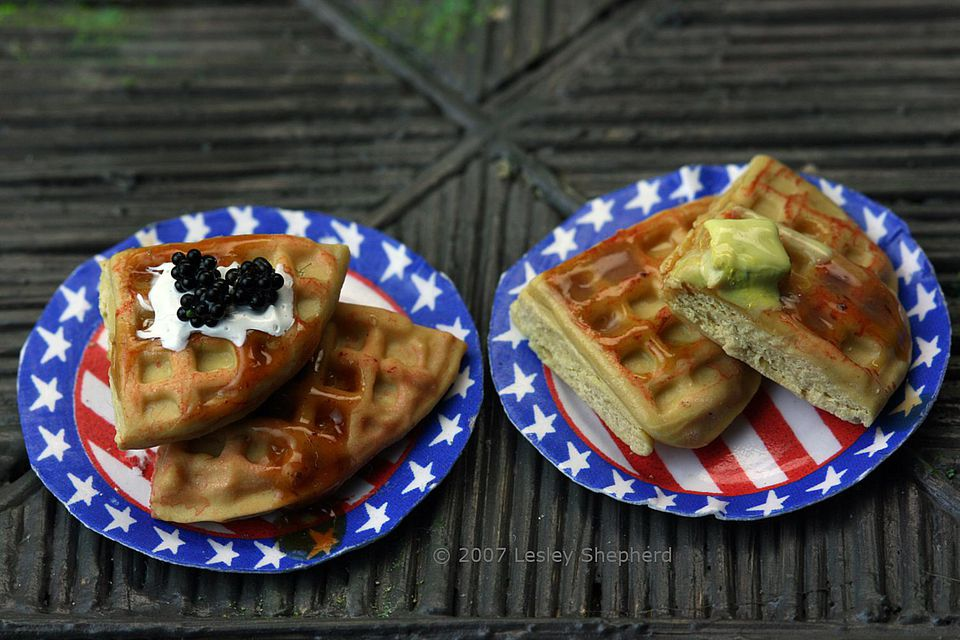 Dollhouse waffles with buter, syrup and blackberries