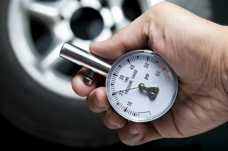 Checking tire pressure to save fuel, reduce emissions, and improve safety.