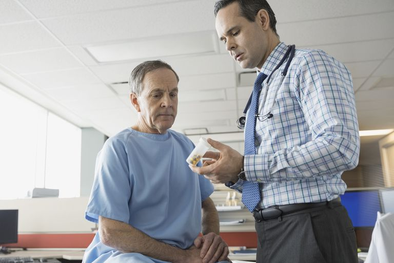 Doctor prescribing medication to older patient